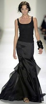 The big bangles, the mixed shaes of black, and the asymmetric cut of the skirt are all big winners in my book.