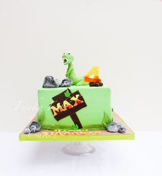 Dino themed cake @funkyfabcakes