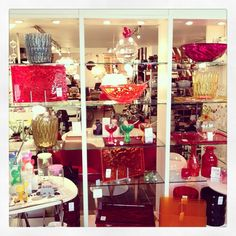 A colourful display at Geoffrey Drayton Epping! Kartell 'Moon' Bowls, 'Dune' Trays & 'Jelly' Vases. 'Matelasse' Vase/Bin.  Also shown Alessi 'Ovo' Storage Jars and 'Big Love' Ice Cream Bowls with heart spoons.  Dartington 'Flower Bottle' Vases
