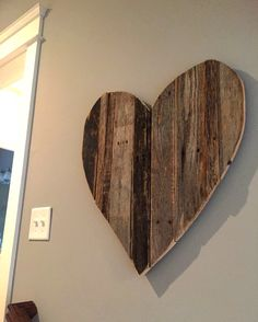 Reclaimed Heart -$55 Constructed of Kentucky Barn and pallet wood. Approximatly 2ft x 2ft. Looks great hanging on any wall in the house. All hanging hardware is included. Each heart is made to order and unique due to the various types of wood we have available in our shop. Can be white washed or customized with painted lettering.