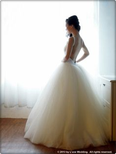 """Robbie Williams - """"She's The One""""  WG025 - An alluring backless ballerina ball gown. With a slimming waistline & voluminous tulle skirt.  #wedding #gowns #dresses #bridal #love #romance #sexy #ballerina"""
