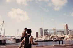 A Pacific Island Man and Boy Plays Rugby against a Cityscape Harbour background. This image is taken at the Waitemata Harbour area of Downtown Auckland, New Zealand. Interracial Marriage, Island Man, Kiwiana, Boys Playing, Fine Art Photography, Royalty Free Images, New Zealand, New York Skyline, Stock Photos
