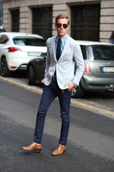 polished blues on blues. matched the tie to the pants. The shoes look great with his hair and coloring. I might have tried a warmer pair of shades.