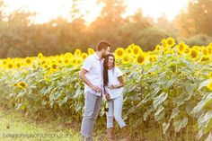 Couple drinking wine in sunflower field during engagement session