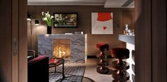 Get a fire going in the living room of the Thompson Suite at Belgraves London