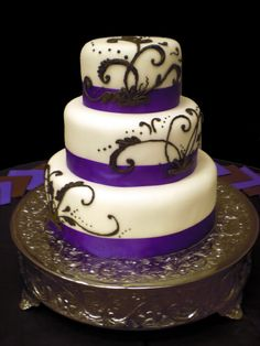 purple white wedding flowers in silver tins | love the look of this wedding cake and it could very easily be ...