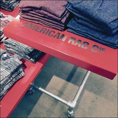If a Horizontal Forward Facing sign is too ordinary for you, consider this upward-facing, table-top, Flat Surface Branding by American Rag®. Red outfitting elements throughout the department give i...