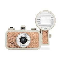 The #Lomography #La_Sardina Grand Cru Camera is a 35mm film toy #camera specifically designed to bring more fun and chance to your shooting routine. This compact, sardine can-shaped camera features a built-in 22mm wide angle lens with a fixed f/8 aperture and two step focusing system. Two shutter speed settings are available, 1/100th sec. or bulb, and unlimited multiple and long exposures are possible.