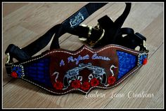 Custom painted bronc noseband, pistols, roses and barbed wire.