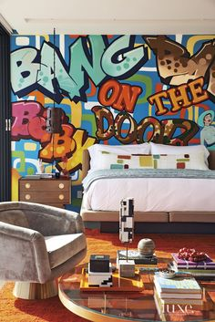 Affectionately known as the Love Shack, the casita boasts a custom graffiti wall commissioned from artists Alynn-Mags; it features lyrics and imagery from the song of the same name. The cantilevered and upholstered Hudson bed is from Cisco Home. Graffiti Furniture, Graffiti Bedroom, Graffiti Wall Art, Bedroom Murals, Bedroom Wall, Wall Murals, Master Bedroom, Bedroom Decor, Wall Decor