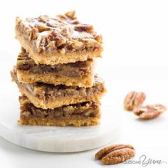 These healthy, paleo pecan pie bars are gooey and crunchy at the same time. Low carb, sugar-free, gluten-free, and super easy to make.