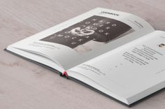 This is a perspective opened hardcover psd book mockup for your to display any print designs in style. You can change...