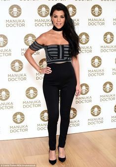 What's the buzz? Kourtney Kardashian looks amazing in a black and grey bardot top and skinny trousers at a London photocall for Manuka Doctor