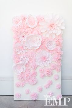 Paper flower wall rental. This is one of three panels. All handmade and custom painted.