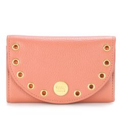 See By Chloé - Kriss leather card holder - See By Chloé's Kriss card holder in dark blush hue has been crafted from textured leather and punctuated with glossy golden eyelet hardware. We love the subtle branding and curved front flap that lends this style a feminine finish. seen @ www.mytheresa.com