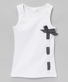 Embellished with a precious polka dot ribbon, this tank will become a little lady's favorite the instant she sets her eyes upon it. The cotton construction ensures that it's always breathable and comfy.