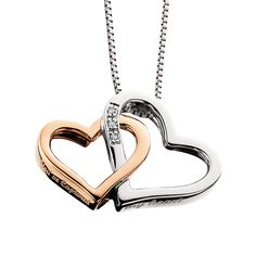 """From the """"You've Captured My Heart"""", collection two delicate hearts connected, one with diamonds one without create this pretty combination. The pendant has """"You've Captured My Heart"""" engraved on the side. Comes with an 18"""" ss chain plus a 2"""" extender chain. Rhodium finish."""