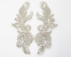 I am all about the rhinestone appliques! I'm going to put them on headbands, garters, and customize my dress with it!