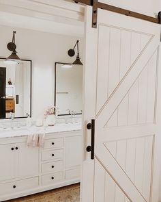 Sliding barn door leading into bathroom
