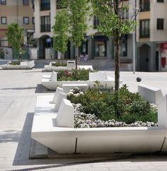 concrete benches - open on two sides? allows ease of planting, maintenance, and good view of plant life