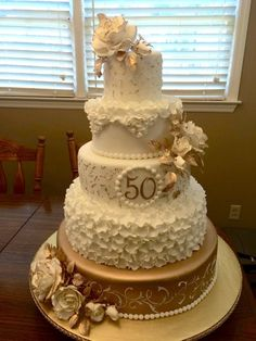 This anniversary cake is has and tiers. Bottom tier is stencil with a scroll stencil from Designer Stencils. Roses and leaves are gumpaste. Bottom tier is painted in gold. Golden Anniversary Cake, 50th Anniversary Cakes, 50th Wedding Anniversary Decorations, Cake Ideas, Wedding Stationery, Wedding Invitations, Leaves, Invitation Cards, Rustic Wedding