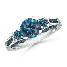Three Stone Engagement Ring in Blue Diamonds (blue diamonds?? would blue topaz or london blue topaz look similar, or maybe even better in tanzanite....)