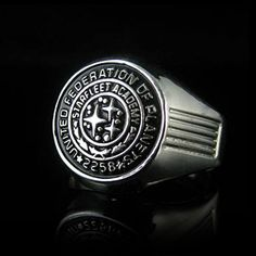 This class ring is a symbol of the achievement of a Starfleet education, and is a replica of the ring worn by Kirk in the 2009 Star Trek film. It includes Kirk's graduation year, 2258, and the Starfleet logo recreated in detail from the prop from the film in polished sterling silver.