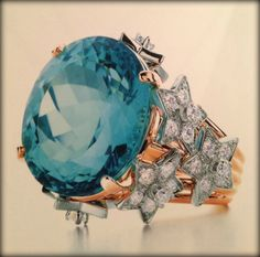 Tiffany stars ring with 16 ct. blue tourmaline and diamonds,18k gold. From the Tiffany Blue Book 2011-2012. #tiffany