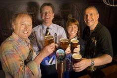 Tim Smit (Left) and Gaynor Coley from the Eden Project celebrate the new Eden Pale Ale with St Austell Brewery director James Staughton and Head Brewer Roger Ryman (Right)