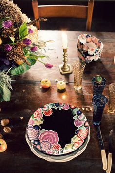 these plates oh the love! Floral edged gypsy pattern plates at wooden table