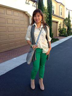 green jeans, print top, grey vest, booties