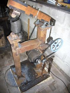 Power hammer with a wooden arm for fullering (lengthening or 'drawing out') iron
