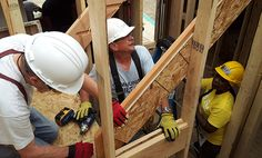 Habitat for Humanity - Volunteers and Homeowner during Blitz Build