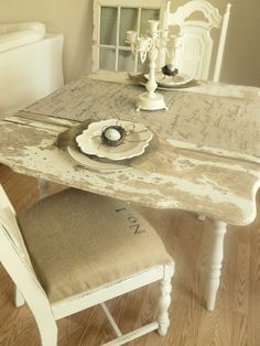 Chippy table & burlap table runner (looks like it's got handwritten fav quotes on it)
