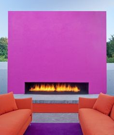 Colour blocking with a hot pink outdoor fireplace, great for a bar #fashion inspired #interiordesign
