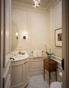 powder room with wainscot wall -- integrated vanity.  built-in at its best