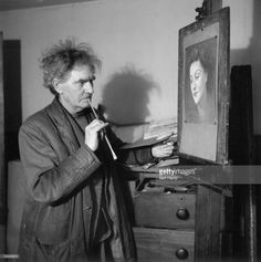 English painter, war artist, occultist and joint editor of the 'Golden Hind' art quarterly, Austin Osman Spare (1886 - 1956) at work on a portrait in his flat in Brixton, South London, 1953. Original Publication: Picture Post 6627 - Austin Osman Spare - unpub - 1953
