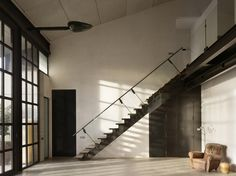 Studio Sitges    The residence by Olson Kundig Architects creates a dual working and living space for two artists. A large below-grade photography studio anchors the building, with several floors for entertaining rising above, culminating in an intimate private space on the top level.