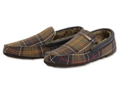 Spoil him with a pair of cozy, faux-shearling-lined suede Monty moccasin slippers by Barbour®. A touch of classic tartan trims the collar, while a hard-wearing sole will let him slip out for a quick trip to the woodpile. Clean with suede brush. Imported. <br />Whole sizes 8-12.