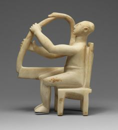 Seated Harp Player, ca. 2800–2700 B.C. Cycladic. The Metropolitan Museum of Art, New York. Rogers Fund, 1947 (47.100.1) | This work is one of the earliest of the few known representations of musicians in art of the Early Bronze Age from the Cycladic islands. Such harp players likely represent significant members of their communities, serving as human repositories and communicators of their people's history, mythology, and music in a time before writing. #OneMetManyWorlds