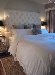 Meredith Heron Designs chic bedroom design with custom made tall white tufted headboard, mirrored nightstands, crisp white bedding, gray velvet pillows, alabaster lamps with black silk shades. For Emma - change headboard to dark grey and curtains to cream Dream Bedroom, Home Bedroom, Fancy Bedroom, Budget Bedroom, Trendy Bedroom, Peaceful Bedroom, Bedroom Interiors, Modern Bedroom Decor, Bedroom Loft