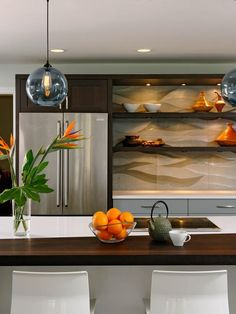 Interesting wall art behind the shelves.  Arts and Crafts Kitchen - 99 Beautiful Kitchen Island Design Ideas on HGTV