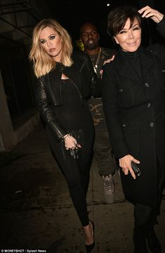 Lean on me: Khloe arrived with Kris Jenner and Kris' boyfriend Corey Gamble and appeared to lean on her mom for support