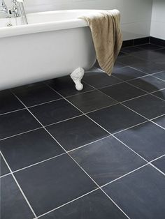 Honed Black Slate This has a nice yellow tone running through it which will complement the grey tiles Black Slate Floor Tiles, Black Bathroom Floor, Slate Flooring, Black Tiles, Bathroom Floor Tiles, Tile Floor, Attic Bathroom, Grey Tiles, Small Bathroom