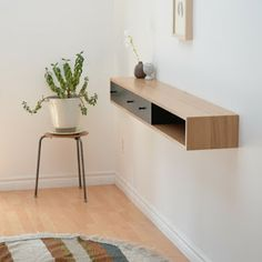 Floating shelf with drawers, works as a console table for a narrow hallway. Good idea to put over a heater as well.