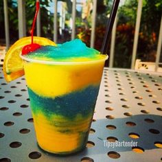 BLUE MANGO DAIQUIRI (pictured) 2 oz. (60ml) White Rum 2 cups Mango 1 1/2 oz. (45ml) Simple Syrup Ice *Blend As you pour mix into glass add Splash of Blue Curacao