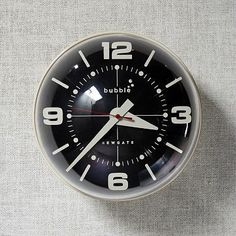 Great timing. Our Newgate Wall Clocks have a 70s retro feel with bold numerals, tapered hands and a silent sweep. Gloss-finished casing eliminates potential glare. Acrylic. Available in two.
