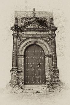 Doors to the Iglesia Santa Maria la Coronada in Medina Sidonia, Andalusia, Spain.