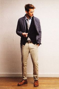 Go for a charcoal cotton blazer and beige chinos to create a smart casual look. Show your sartorial prowess with a pair of brown leather derby shoes.  Shop this look for $219:  http://lookastic.com/men/looks/longsleeve-shirt-and-tie-and-cardigan-and-belt-and-blazer-and-chinos-and-derby-shoes/3776  — Light Blue Gingham Longsleeve Shirt  — Grey Tie  — Black Cardigan  — Dark Brown Leather Belt  — Charcoal Cotton Blazer  — Beige Chinos  — Brown Leather Derby Shoes
