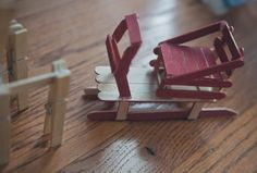 Popsicle stick sleigh for santa with clothespin and craft stick reindeer